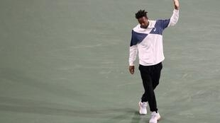 No go: Gael Monfils of France apologizes to the crowd after withdrawing from ATP Indian Wells Masters quarter-final with Achilles tendon inflammation