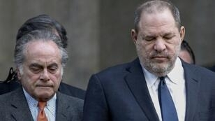 Defense lawyer Benjamin Brafman (L), seen here with Harvey Weinstein(R) after a court hearing in New York on December 20, 2018, is withdrawing from the movie mogul's sexual assault case