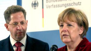 المستشارة الألمانية أنغيلا ميركل ورئيس جهاز الاستخبارات المقال