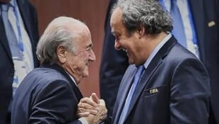 Fabrice Coffrini / AFP | Sepp Blatter et Michel Platini
