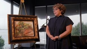 "A Pierre Auguste Renoir painting ""Femmes Dans Un Jardin,"" stolen by the Nazis, has been returned to the heir of its rightful owner, Sylvie Sulitzer, seen here at a ceremony at the Museum of Jewish Heritage in New York"
