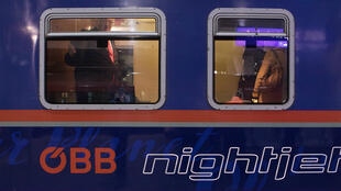 Passengers board the first night train heading to Brussels before its departure on January 19, 2020, after the inauguration of the new night-train connection from Vienna to Brussels.