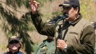 Venezuelan President Nicolas Maduro (R) is desperately trying to hold onto power in the face of opposition leader Juan Guaido's audacious bid to assume the country's top office on an acting basis