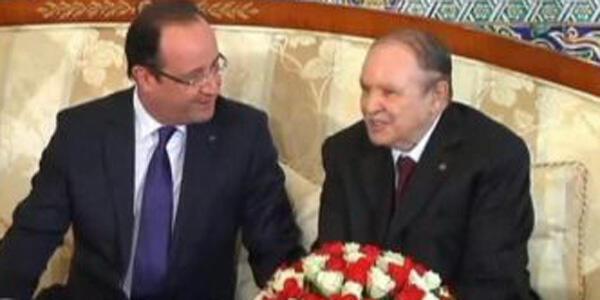 صورة لبوتفليقة وهولاند خلال الزيارة التي قام بها الرئيس الفرنسي للجزائرفي ديسمبر 2012