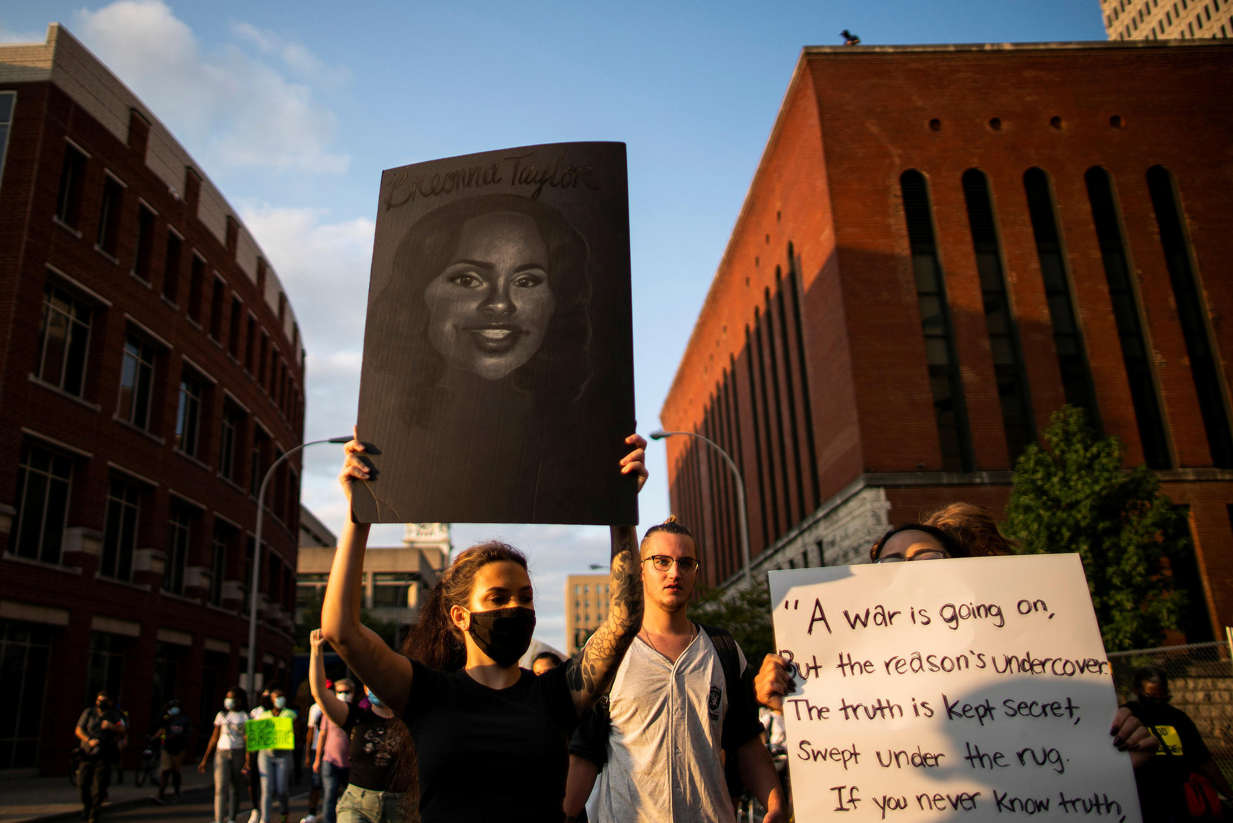 Protesters march during a peaceful protest after a grand jury decided not to bring homicide charges against police officers involved in the fatal shooting of Breonna Taylor, in Louisville, Kentucky September 26, 2020.