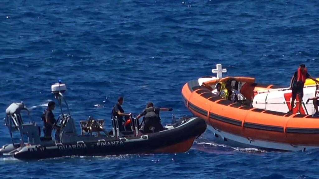 Migrants on Open Arms ship disembark in Lampedusa in surprising about-face from Italy