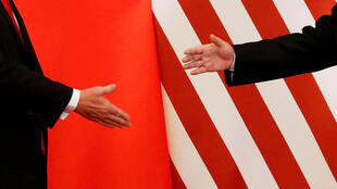 "China announced on Friday a ""phase one"" trade deal with the United States that includes a progressive rollback of tariffs and the protection of intellectual property rights, but the two sides have yet to sign the agreement."