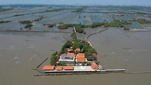 A dangerous combination of climate change, industrial farming and rapid urbanisation are endangering the Gulf of Thailand's coasts, stripping away precious mangrove trees and leaving some buildings like the temple at Samut Chin surrounded by sea water