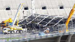 The accident occurred when one of four cranes putting up metal scaffolding for the stage knocked into the structure's roof