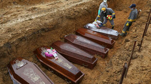 Victims of the coronavirus are buried in Manaus, Brazil, on May 6, 2020