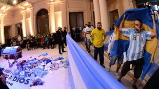 Fans pay homage to Diego Maradona at the Casa Rosada presidential palace in Buenos Aires, Argentina on November 26, 2020.
