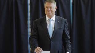 Incumbent candidate Klaus Iohannis smiles as he casts his ballot in the first round of a presidential election, in Bucharest, Romania, on November 10, 2019.