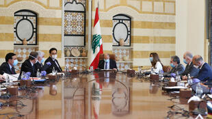 Lebanon's President Michel Aoun (C) chairs a meeting on his country's economic crisis at the presidential palace in Baabda, east of the capital Beirut, with all participants wearing protective masks
