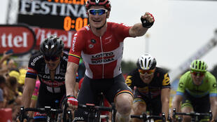 Germany's Andre Greipel celebrates as he crosses the finish line on July 19.