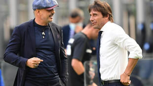 Bologna coach Sinisa Mihajlovic (L) talks with Inter Milan's Antonio Conte before a Serie A match behind closed doors in the San Siro.