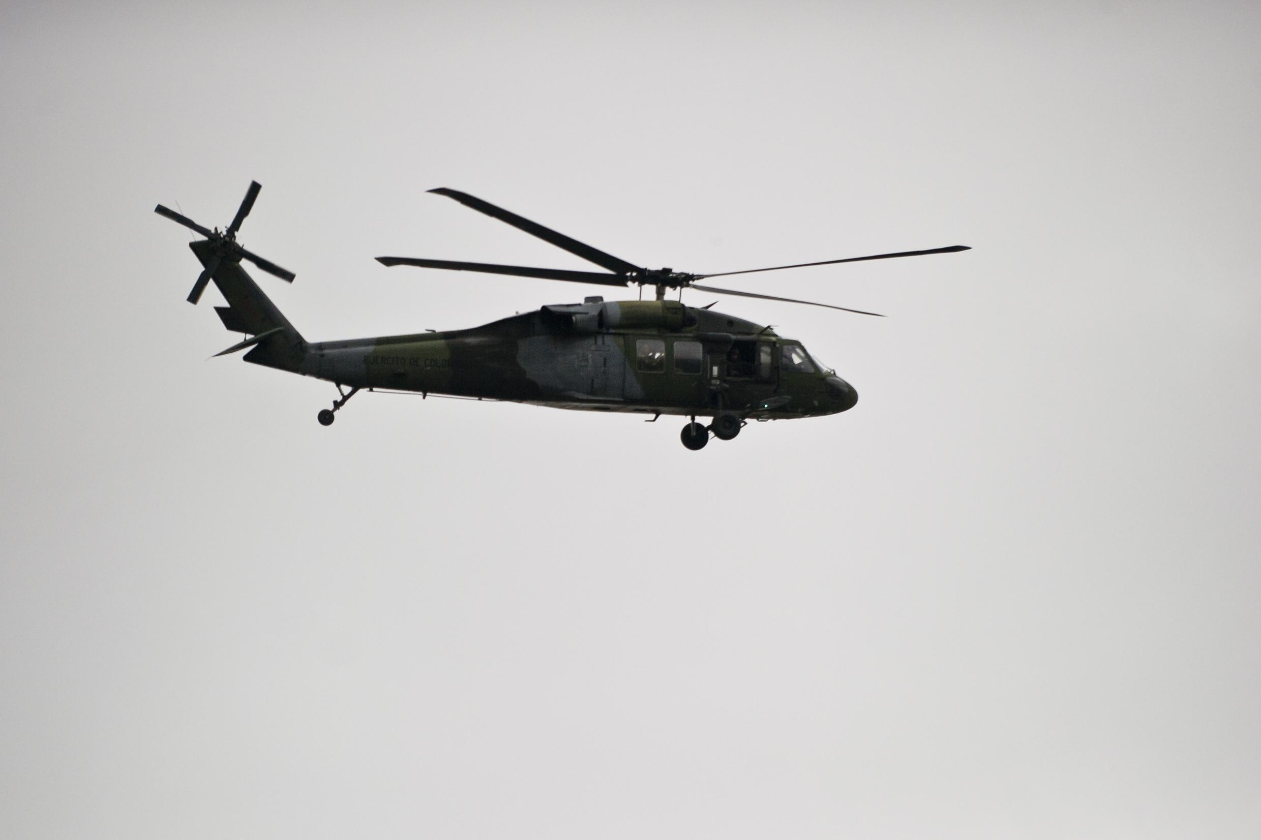 A Colombian Army Black Hawk helicopter flies over an area where a FARC guerrillas attack took place in Cali, Colombia, in April 2015