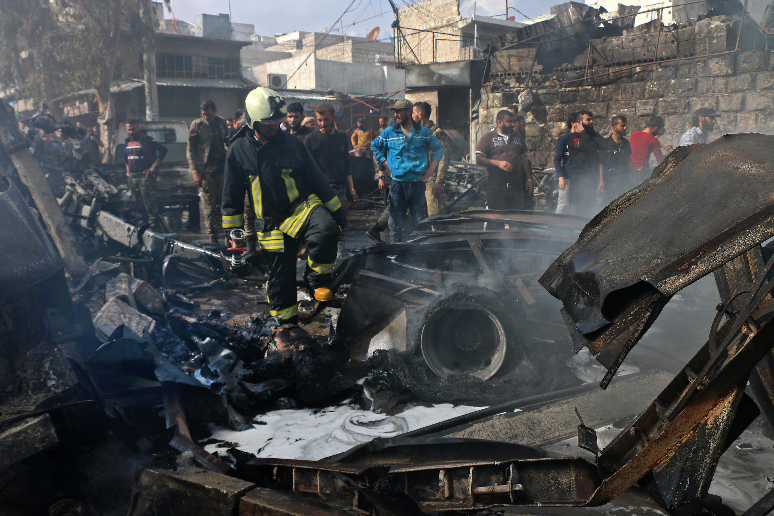 A picture released by the Syrian Civil Defence rescue workers shows the scene of a fuel truck bomb on April 28, 2020 in the northern Syrian city of Afrin,