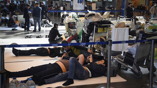 Travellers wait for flights to get back home at Moscow's Vnukovo airport