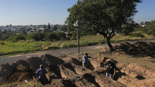 Grave diggers prepare plots at the San Vicente cemetery in Cordoba following a spike in coronavirus cases