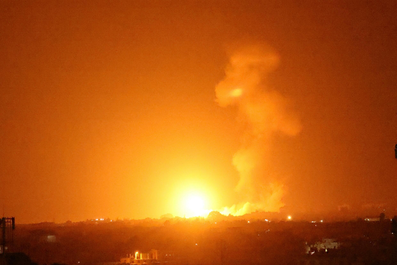 A fireball rises following an Israeli air strike in Khan Yunis in the southern Gaza Strip