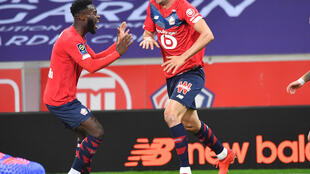 Burak Yilmaz (R) set Lille on their way to top spot in Ligue 1