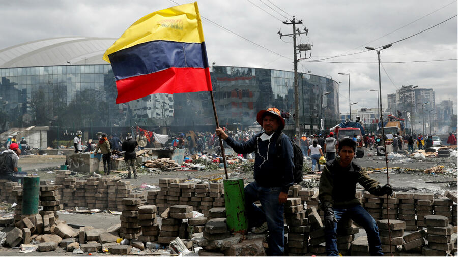 People gather in the aftermath of protests against Ecuador's President Lenin Moreno's austerity measures, after Moreno imposed a military-enforced curfew in the capital Quito, Ecuador October 13, 2019.