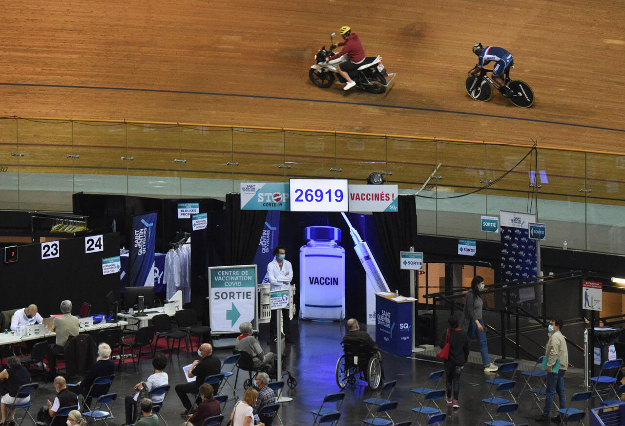 A scoreboard indicates the number of doses administered since the vaccination centre opened at the Saint-Quentin-en-Yvelines velodrome, outside Paris. Between 1,500 and 2,000 doses are injected daily.