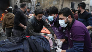 Rescue workers at the scene of an explosion in the town of Azaz in the rebel-controlled northern countryside of Syria's Aleppo province