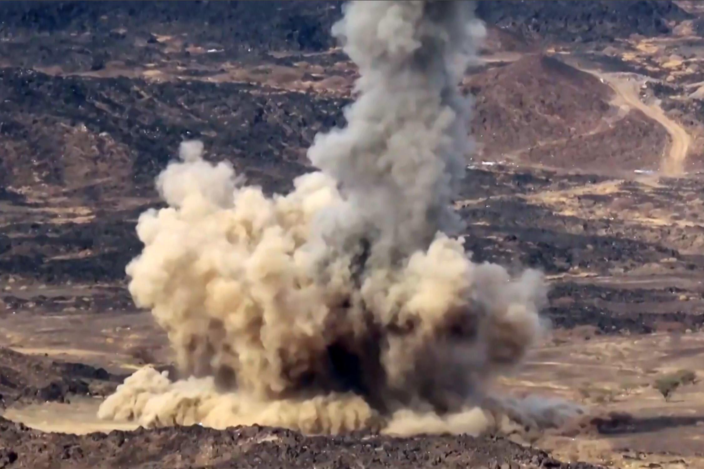 A file picture from June 28, 2021 shows an explosion from a projective fired during fighting for Yemen's Marib