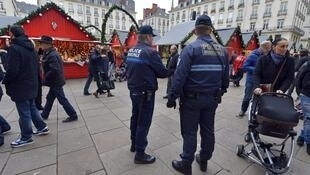 Police officers patrol the Christmas market in Nantes on December 23, 2014