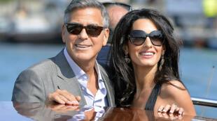 George Clooney et Amal Alamuddin lors de leur arrivée à Venise, vendredi 26 septembre