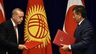 """Turkish President Recep Tayyip Erdogan, seen meeting Kyrgyz counterpart Sooronbay Jeenbekov, said he would not want his hosts """"to have the same problems we faced,"""" referring to the 2016 failed coup Ankara blames on Gulen backers"""
