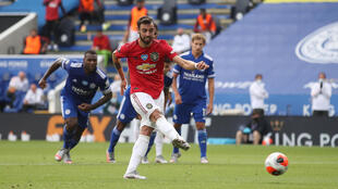 Manchester United's Bruno Fernandes scores their first goal from the penalty spot at the King Power Stadium in Leicester.