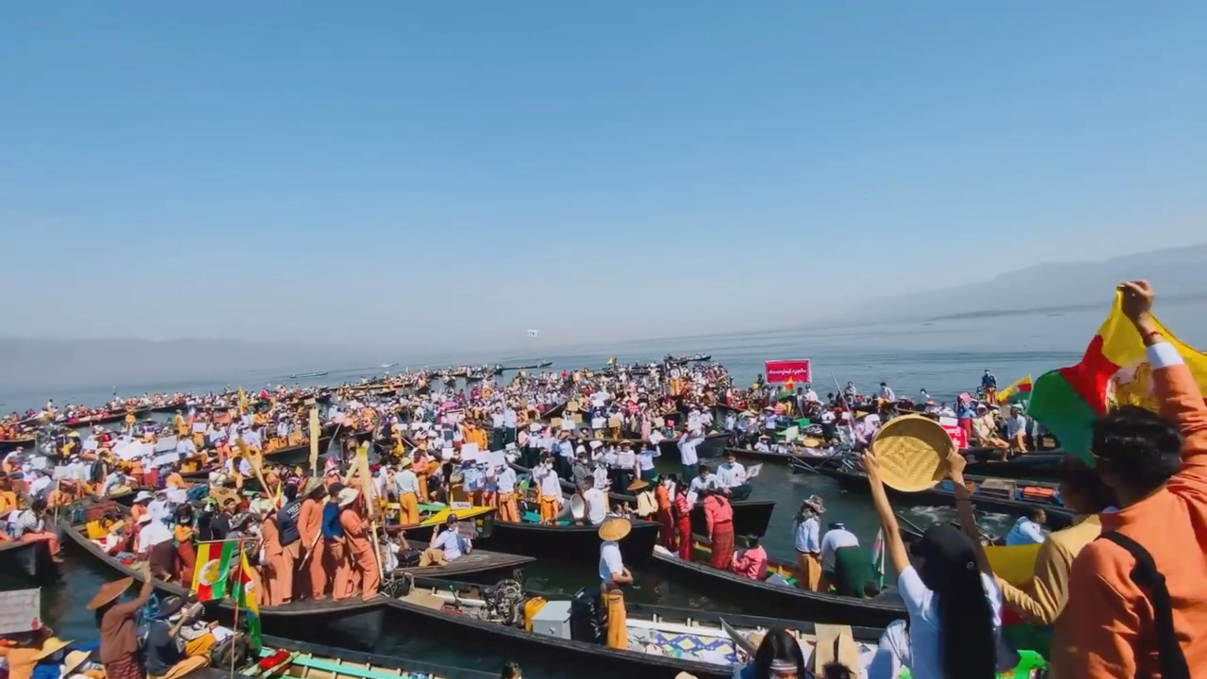 Pro-democracy protests gather on boats at a rally at Inle Lake, Myanmar February 11, 2021 in this still video image obtained by REUTERS.
