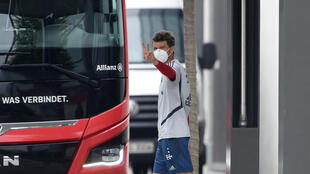 Bayern Munich forward Thomas Mueller wearing a face mask on the way to team training.