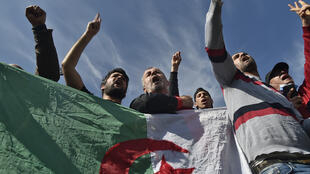 Algerians waving flags gathered outside the Kolea prison on Friday to await activists expected to be freed under a presidential pardon
