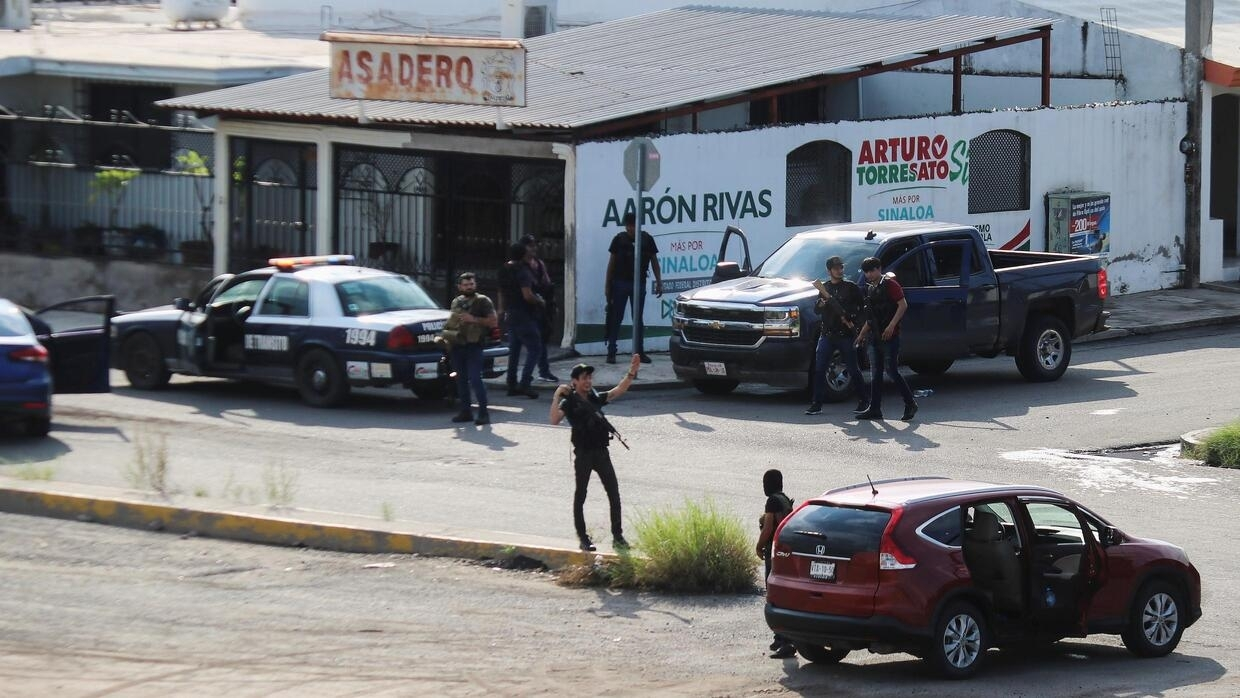 Gunfight rages in Mexico after troops arrest then release El Chapo's son