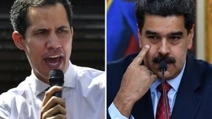Venezuela's National Assembly head Juan Guaido (L) has declared himself acting president, replacing Nicolas Maduro, in a move not recognized by the latter