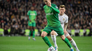Real Sociedad's Norwegian midfielder Martin Odegaard (L) vies with Real Madrid's German midfielder Toni Kroos during the Spanish Copa del Rey (King's Cup) quarter-final football match Real Madrid CF against Real Sociedad at the Santiago Bernabeu stadium in Madrid on February 06, 2020.