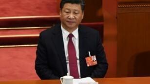 الرئيس الصيني شي جينبينغ في الجمعية الوطنية الشعبية في بكين في 09 آذار/مارس 2018