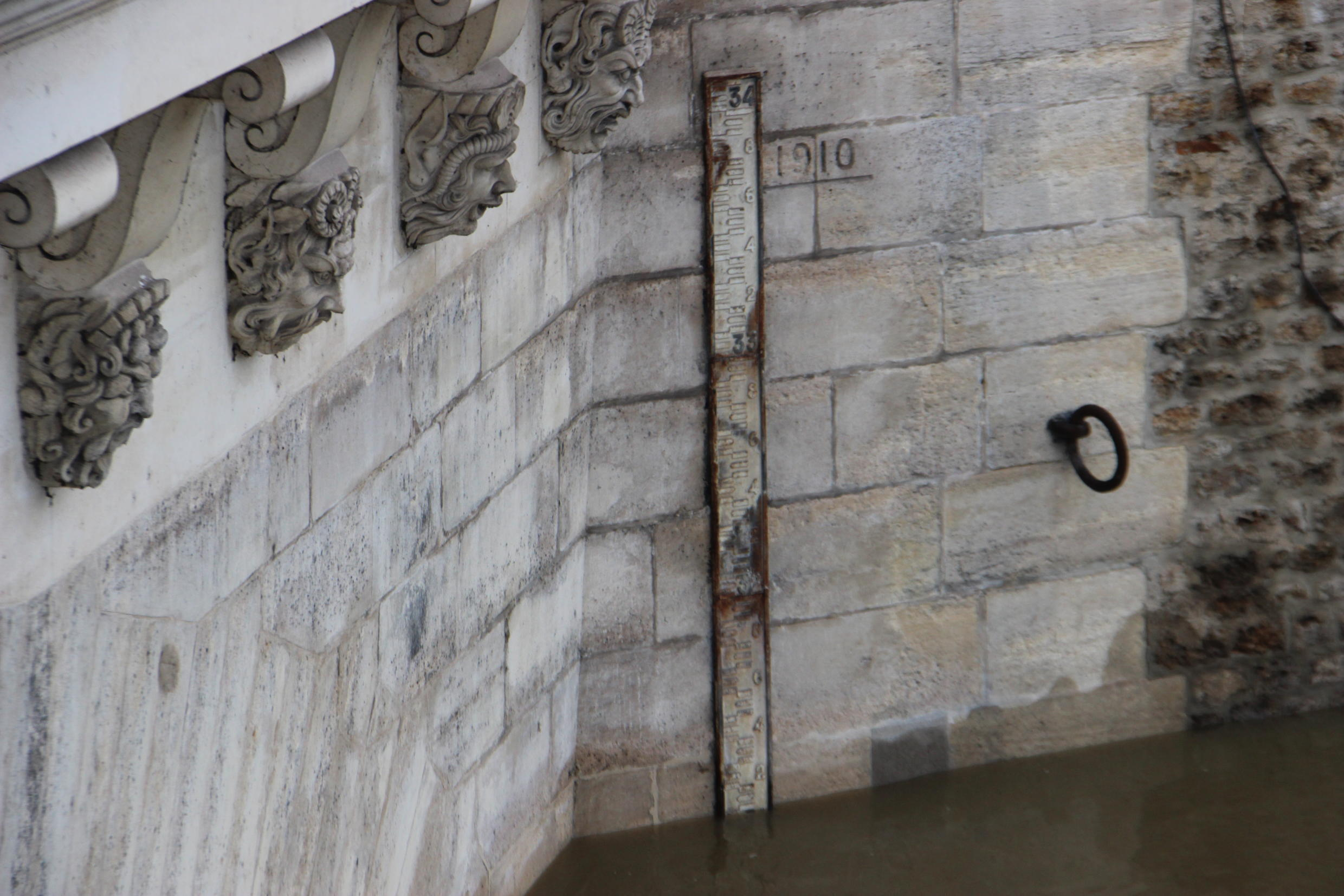 The 1910 flood was captured in stunning photos, and reminders of the dangerous surge can be still be found around central Paris.
