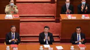Xu Zhangrun was deeply critical of China's President Xi Jinping (centre)