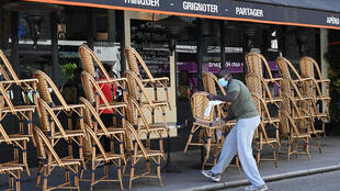 A barman in Paris setting up outside seating ahead of the partial reopening of restaurants and bars in the French capital on June 2.