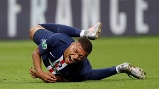 Kylian Mbappé hobbled off the pitch after a clumsy tackle during PSG's French Cup final victory at the Stade de France on Friday.