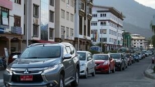 Famed for valuing Gross National Happiness over economic growth, Bhutan is a poster child for sustainable development but booming car sales may impact efforts to preserve its rare status as a carbon negative country