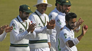 Hasan Ali holds the ball after taking five wickets at the end of the South Africa's innings during the third day of the second Test cricket match between Pakistan and South Africa