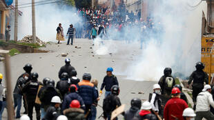 Supporters of Bolivian President Evo Morales and opposition supporters clash during a protest after Morales announced his resignation on Sunday in La Paz, Bolivia, on November 11, 2019.