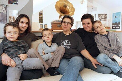 Corrine Cestino and Sophie Hasslauer with their four children: the eldest (16), from a previous relationship, and the younger three (aged between six and ten), conceived through artificial insemination in Belgium (prohibited for homosexual couples in France).