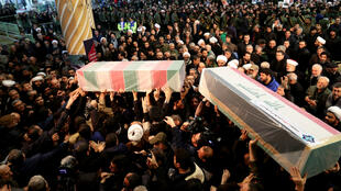 Coffins bearing the bodies of Iranian general Qassem Soleimani and Iraqi militia leader Abu Mahdi al-Muhandis are carried by mourners in Tehran on January 6, 2019.