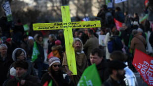 Thousands of opponents to France's new bioethics bill, which aims in part to extend medically assisted reproduction, known by the acronym PMA in French, to lesbian couples and single women, demonstrate in Paris on January 19, 2020.